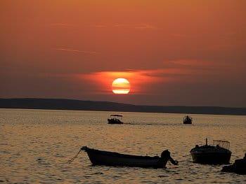 Rybáři při západu slunce